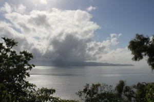 Magnetic Island nestles under early cloud. Photo M. Tattersall.